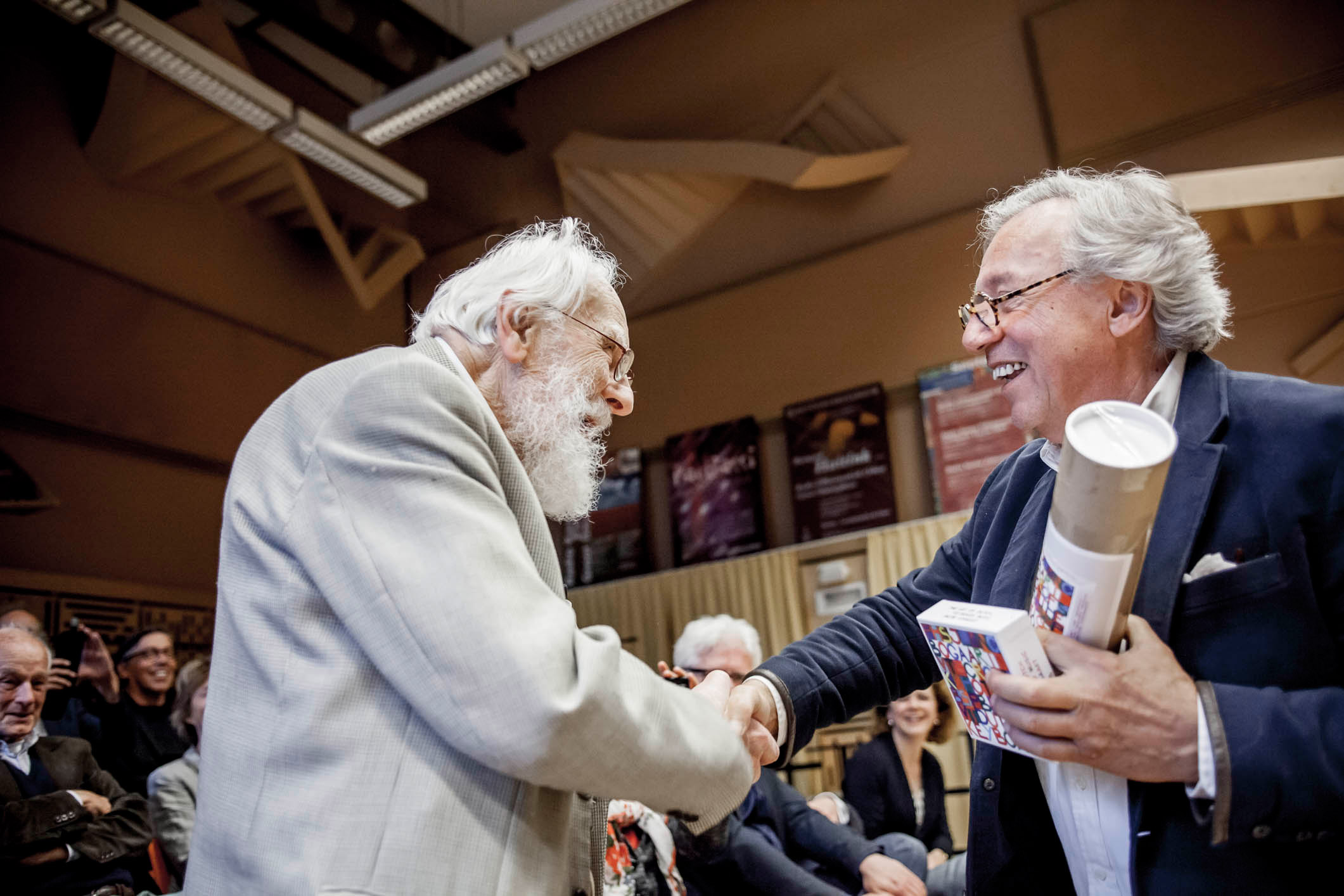 The first copy of 'The Art of Dutch Keyboard Music' is handed over by Jacob Bogaart to Jan van Dijk, oldest living pupil of Willem Pijper in the MCO Hilversum, May 2015.